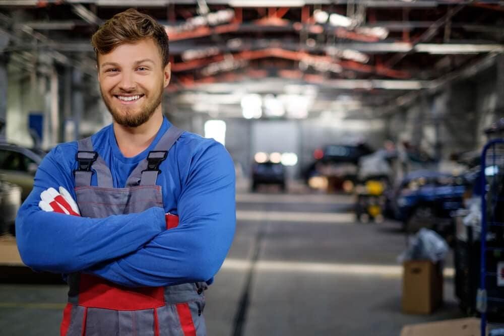 Mechanic standing in service department