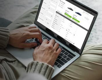 Man using digital retailing tool on laptop