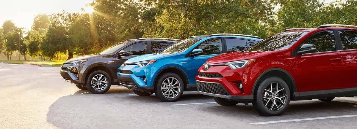 3 Rav4s in a parking lot