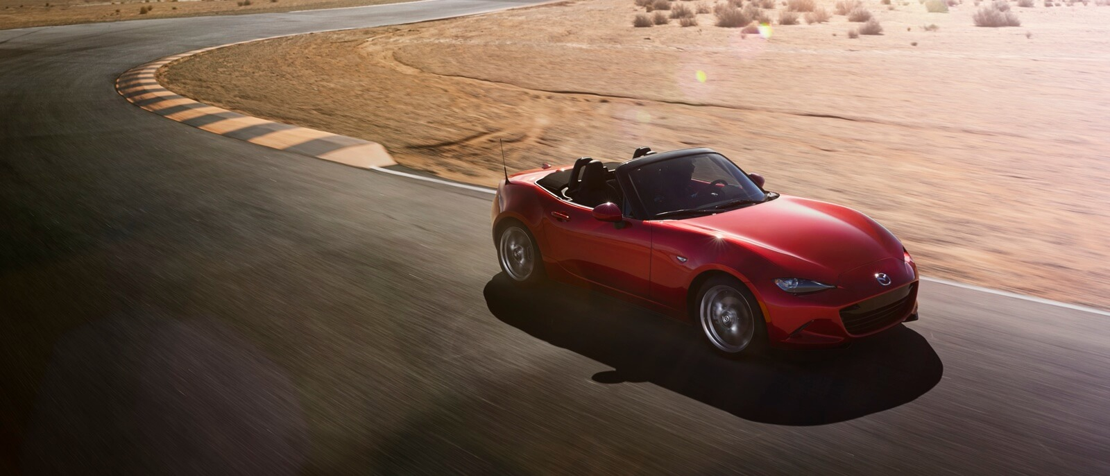 red 2016 Mazda MX-5 Miata on the road