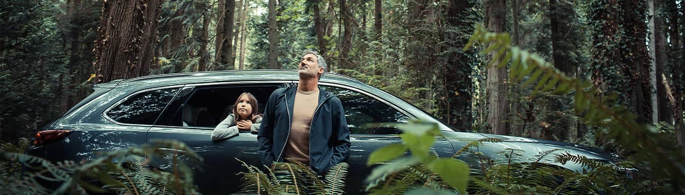 Dad and daughter in the woods with Mazda CX-9