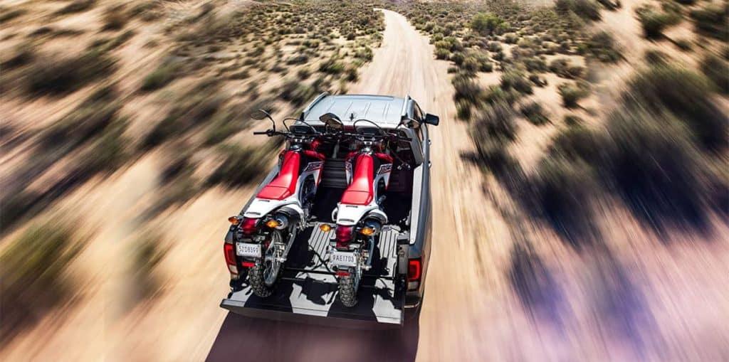 2019 Honda Ridgeline hauling bikes in the desert