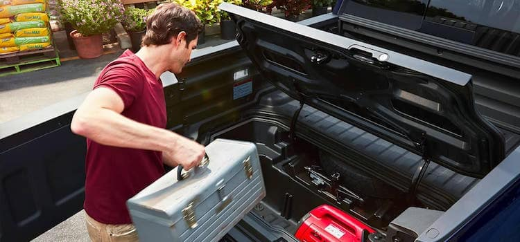 Man Loading Toolbox Into Honda Ridgeline Truck Bed