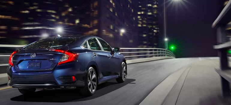 Blue Honda Civic Driving at Night
