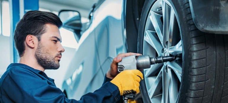 mechanic rotating tire